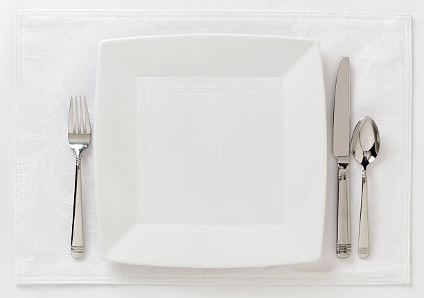 Contemporary table place setting; white on white; area for copy left open