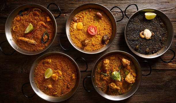 Paellas five rice recipes from Spain on wood table
